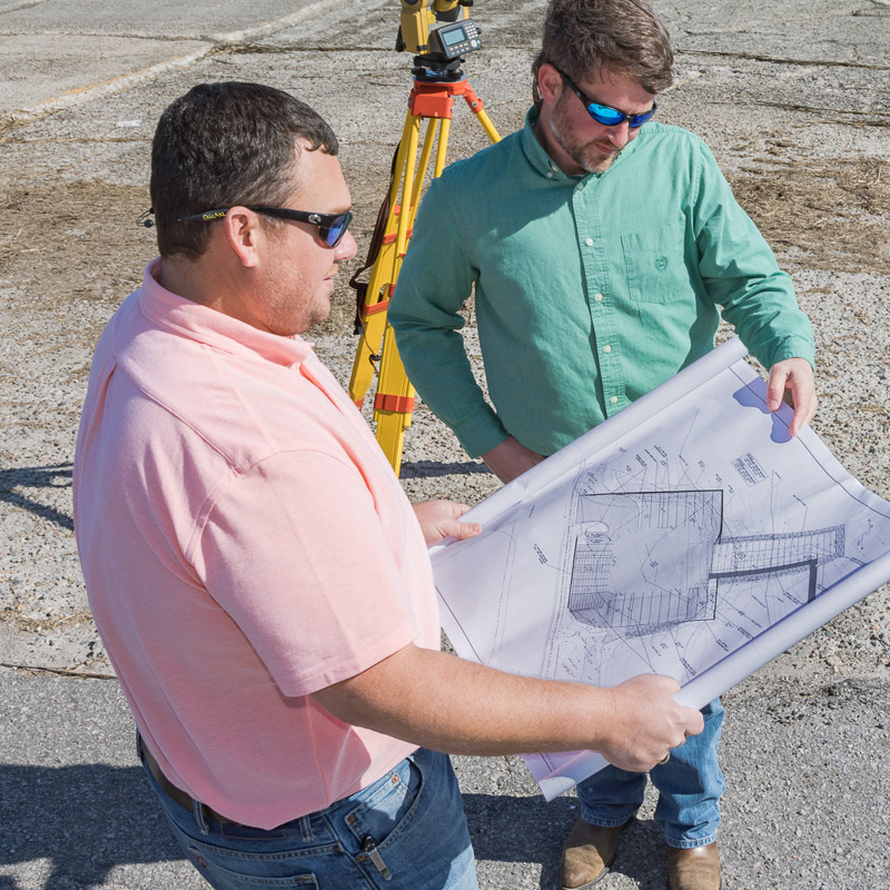 Engineers conduct land planning on site